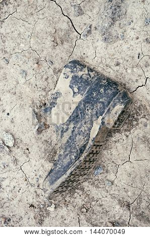 worn black military boots lying on the dry ground retro tuning