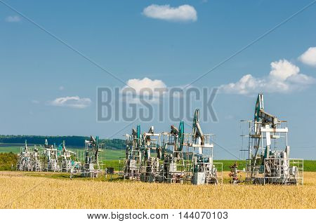 oil pump. Oil industry equipment. filtered picture of oil pump jack. Oil and gas industry. Work of oil pump jack on a oil field