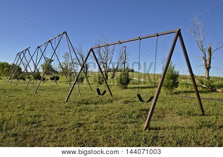 Multiple swing sets on a schoolyard playground