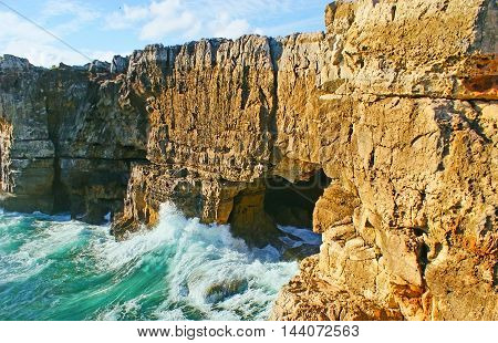 The cave in coastal rocks of Cascais is famous as the Boca do Inferno (The Jaws of Hell) or the Devil's Cave Portugal.