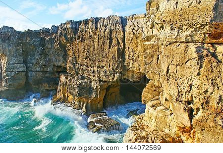The Devil's Cave in Cascais is the place of tourist interest the waves with a terrible noise enter the grotto that's why this place is named so Portugal.