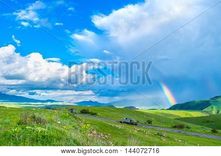 The rain in highland with the bright rainbow among the clouds Syunik Province Armenia.