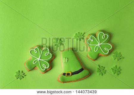 Decorative cookies on green background. Saint Patrics Day concept