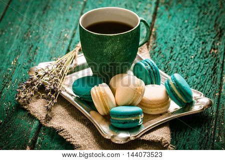 Fresh Macaroons And Tea Cup On Wooden Table .vintage Filter