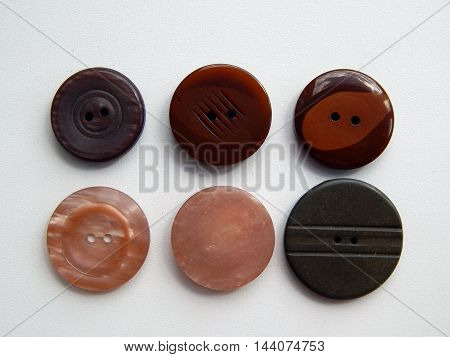 Arrangement of buttons for clothing sets and fashion