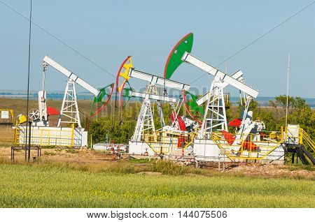 oil pump. Oil industry equipment. filtered picture of oil pump jack. Oil and gas industry. Work of oil pump jack on a oil field.