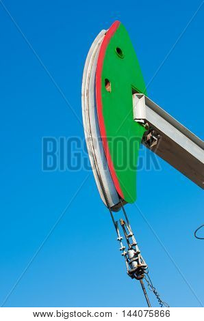 Oil Rocking Chair Closeup. Oil Rocking Chair On A Background Of Blue Sky.