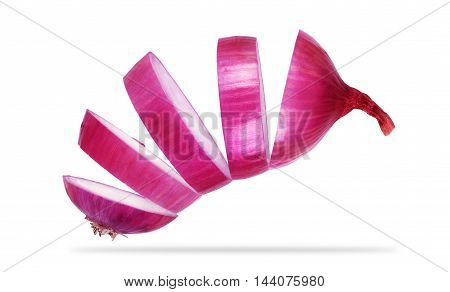 sliced and falling red onion isolated on white background