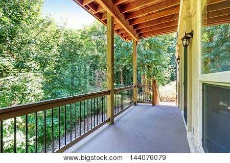 Covered Deck With Railings And Forest Landscape