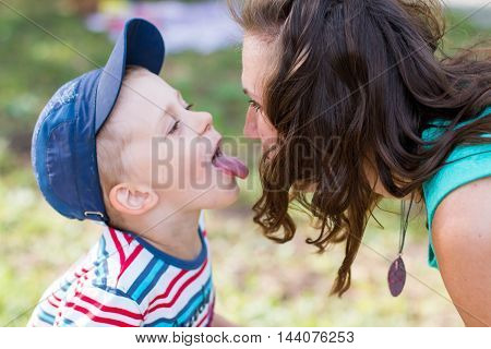 Mom And Small Boy Outdoor In A Summer Day