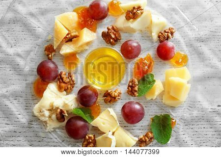 Plate with tasty cheese