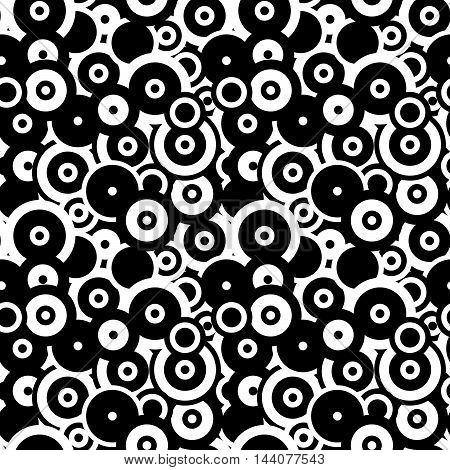 A lot of black and white circles and rings abstract seamless pattern