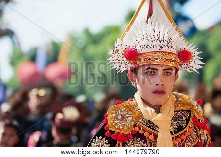 Denpasar Bali Island Indonesia- June 11, 2016: Portrait of the man dressed in colorful ethnic Balinese people costume before dancing traditional ritual temple dance Baris at Art and Culture Festival