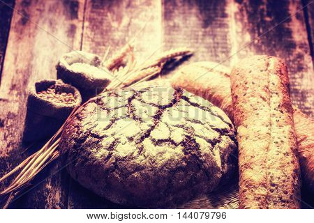 Fresh bread on wooden table vintage filter
