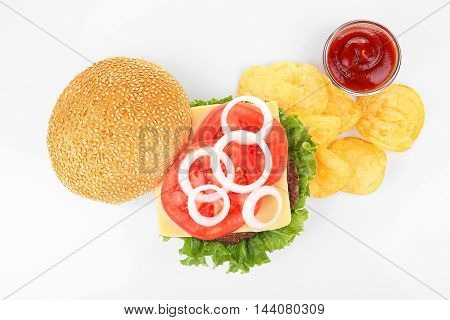 Tasty hamburger with potato chips, isolated on white