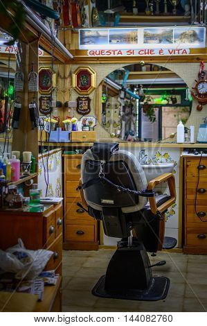 Naples (Napoli) Italy - June 10: Hairdressing salon June 10 2016 in Naples Italy. Interior with chair in beauty salon.