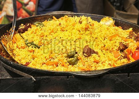 Delicious pilaf in iron pan