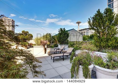 Apartment Building Roof Top Terrace Exterior With Lounge Chairs