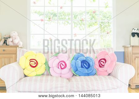 Colorful pillow on sofa in living room.