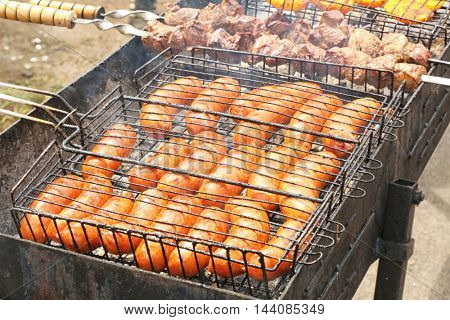 Sausages on grill grate