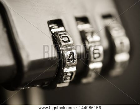 Macro of combination lock Selective focus with a silver number dial