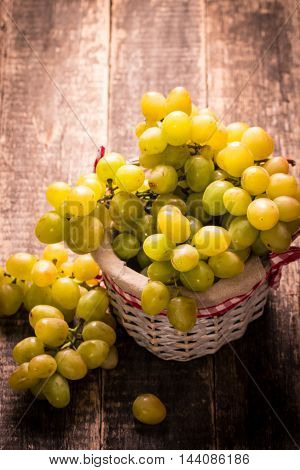 Bunch Of Grapes And In Basket On Wooden Table.