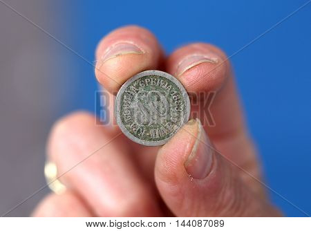 picture of a Fingers hold old coin from Serbia kingdom