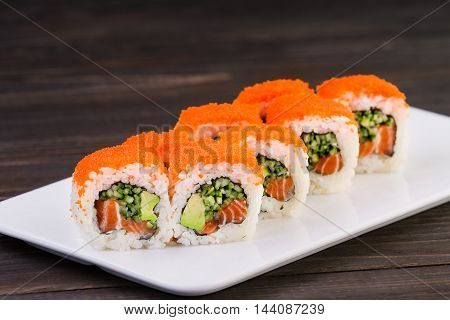 Sushi Roll On Plate On Wooden Background . They Were 8 Pieces .