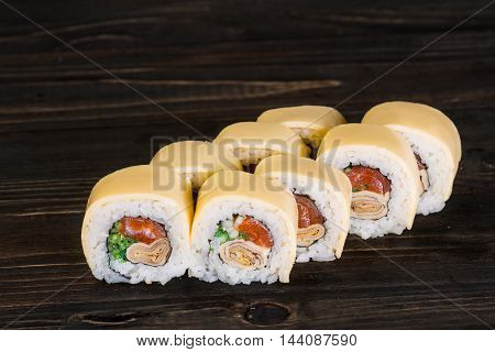 Sushi Roll On Wooden Background . They Were 8 Pieces .