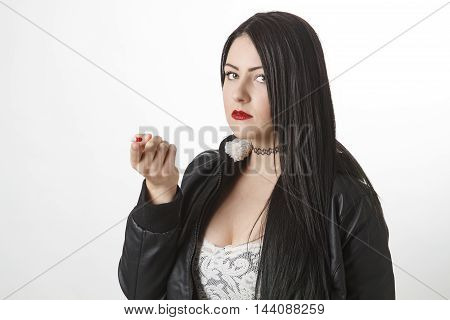 Holding A Pill On Her Finger