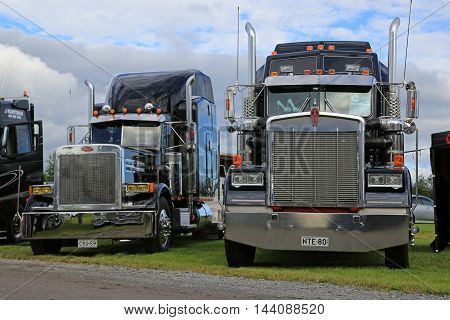ALAHARMA, FINLAND - AUGUST 12, 2016: Classic Kenworth W900 on display beside Peterbilt semi truck on the annual trucking event Power Truck Show 2016.