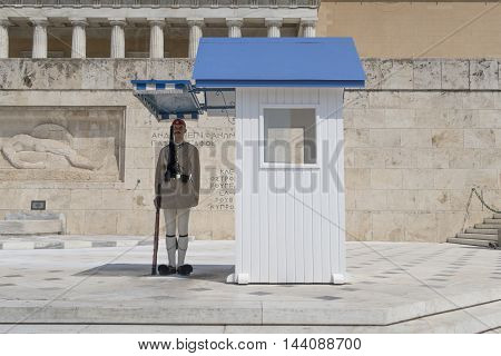 Athens, Greece - August 06 2016: A presidential guard at Greek Parliament square. Eyzones are members of the Greek Army with traditional uniforms and guard in pairs the Tomb of The Unknown Soldier.