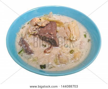Spicy creamy coconut soup with chicken , Thai food called Tom Kha Gai isolated on white backgroung