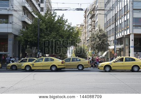 Athens, Greece - August 06 2016: Yellow taxis on Syntagma square. About 14.000 taxis are in operation in Athens.