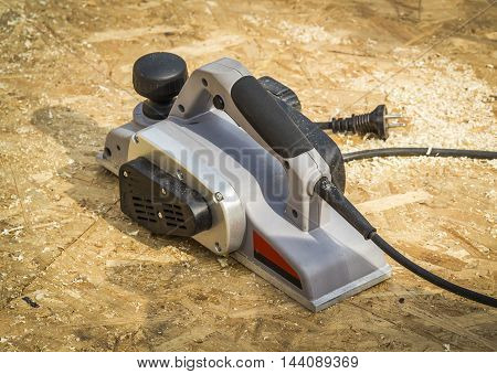 Gray electric planer on a construction site close-up