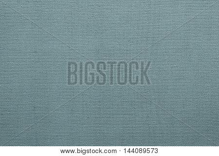 surface of fluted fabric or textile material for the textured wallpaper and for a background of monochrome blue color