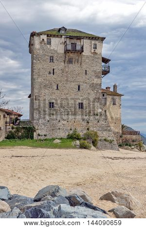 Amazing view of Beach and Medieval tower in  Ouranopoli, Athos, Chalkidiki, Central Macedonia, Greece