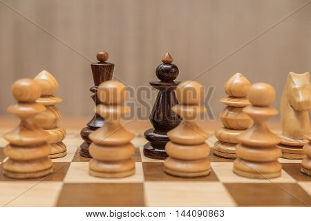 Chess pieces king and queen on the chess board