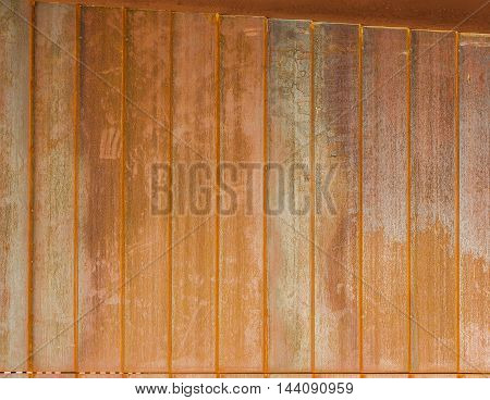 A rusty and grungy metal panel background.