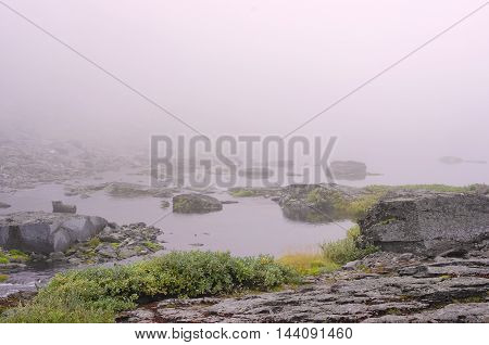 Mist over the surface of the water Lake of the mountain lake
