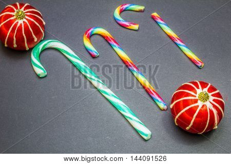 Mint Hard Candy Cane Striped With Red Ball In Christmas Colours On A Black Background
