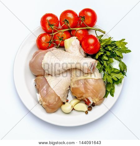 Raw chicken legs isolated on a white background