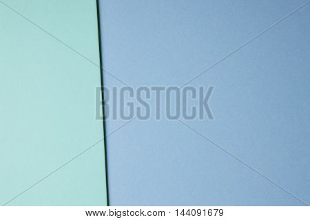 Colored cardboards background in blue green tone. Copy space. Horizontal