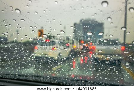 Color effect and selective focus, Rain Drops On The Glass Electric light In Background (raindrops,outdoor, traffic)