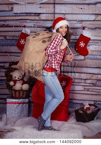 Girl with a bag of gifts. The concept of New Year and Merry Christmas