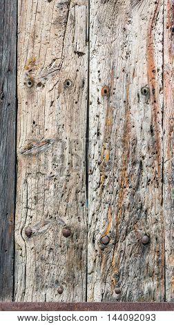 Weathered Wooden Door Background With A Metallic Rusty Screws.