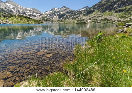 Amazing view of Demirkapiyski chuki and Dzhano peaks, Popovo lake, Pirin Mountain, Bulgaria