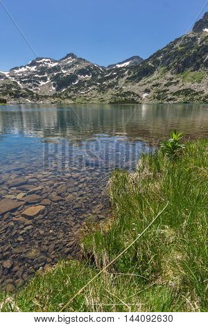 Amazing landscape of Demirkapiyski chuki peak and Popovo lake, Pirin Mountain, Bulgaria