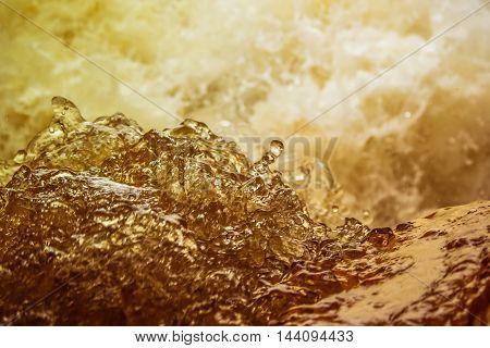 Beer with foam splash . . .