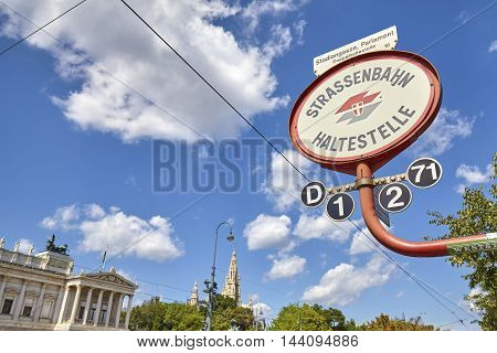 Vienna Austria - August 14 2016: Tram stop sign in front of Austrian Parliament building. Vienna Tram network is one of the largest in the world.